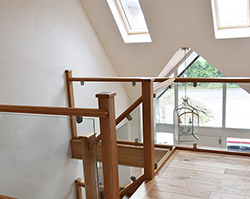 A stunning internal staircase made from clean wood and open glass.