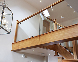 A stylish glass balcony made from clear glass.