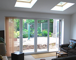 Large glass doors that allow plenty of natural light into the extension.