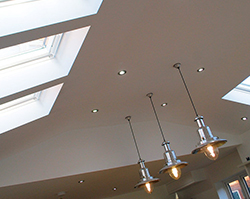 Stylish lighting sat between skylights that allow natural light.