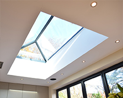 The sun shining through a stylish skylight.