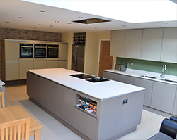 A modern kitchen consisting of cool, crisp colours.